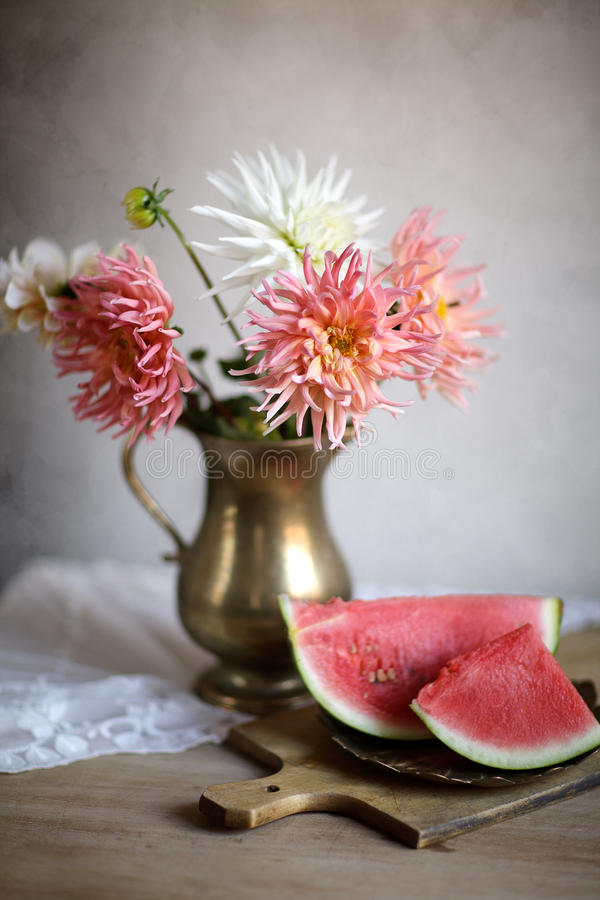 Still Life. Decorative Still-Life with Dahlia flowers and Watermelon stock image
