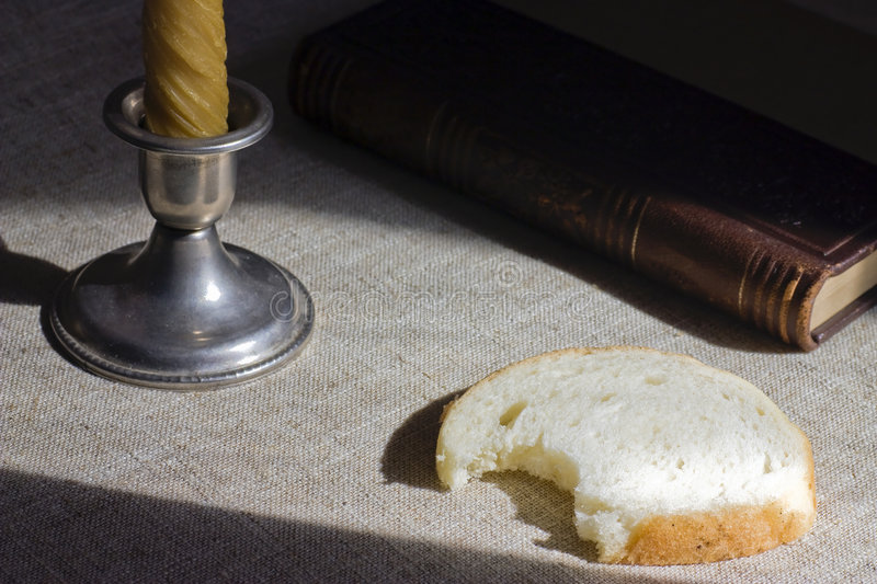 Still life. Candle, bread and Bible stock photo