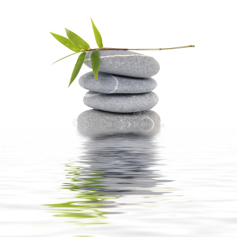 Still of life. Reflection for zen stack stones and bamboo leaf royalty free stock photos