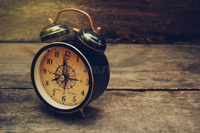 still life with alarm clock on wood table stock photo image of counting second 69440842. Black Bedroom Furniture Sets. Home Design Ideas