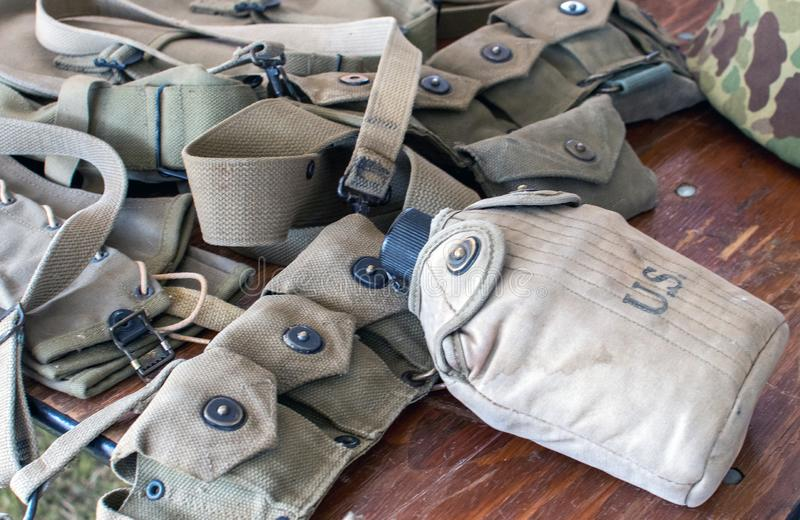 Military ammo belt and canteen for an American soldier stock image