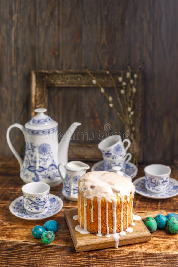 Easter table with Easter cakes and Easter eggs with willow branches. Still life with an ancient frame for a picture in the backgro. Still life with an ancient royalty free stock photo