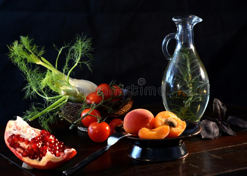 Food still life with apricots and pomegranate royalty free stock images