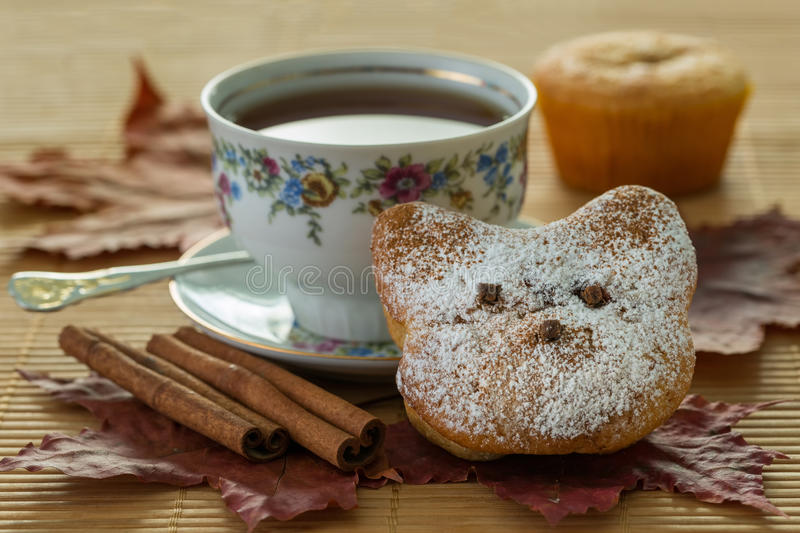 Still life with autumn leaves and muffins royalty free stock photo
