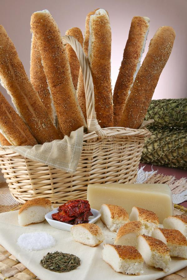 Still life baguette with oregano and cheese. basket with bread sticks. Gourmet royalty free stock image
