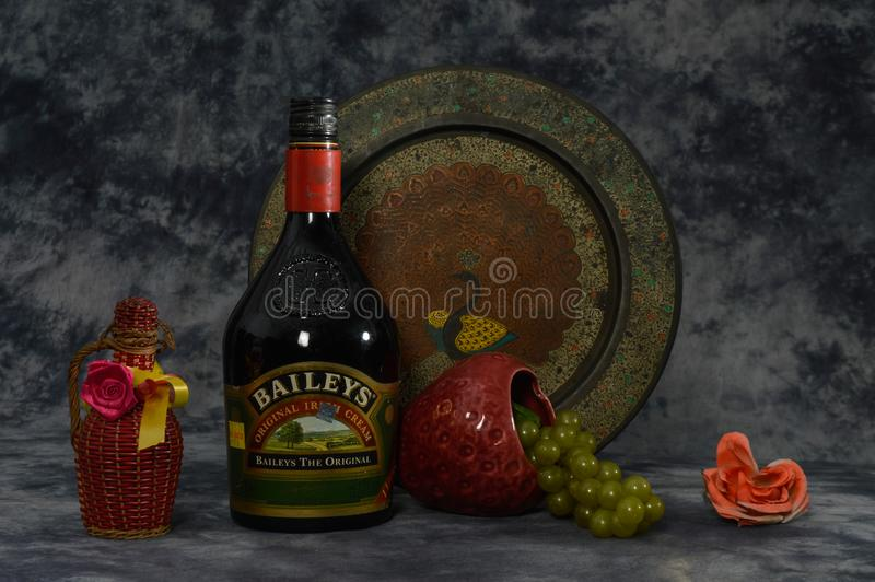 Still life with baileys, grapes, flower isolated on the cloth background with art work stock image