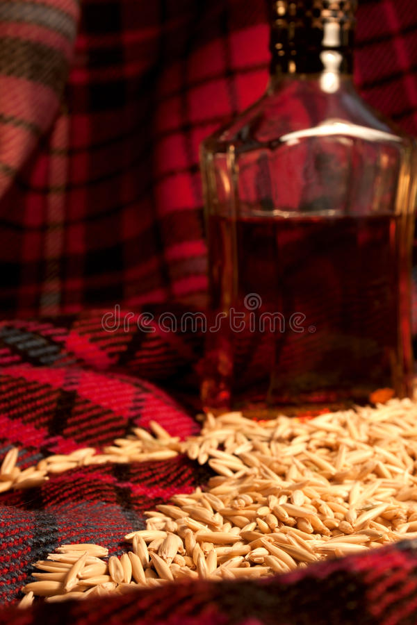 The still life with the barley and whiskey bottle stock photo