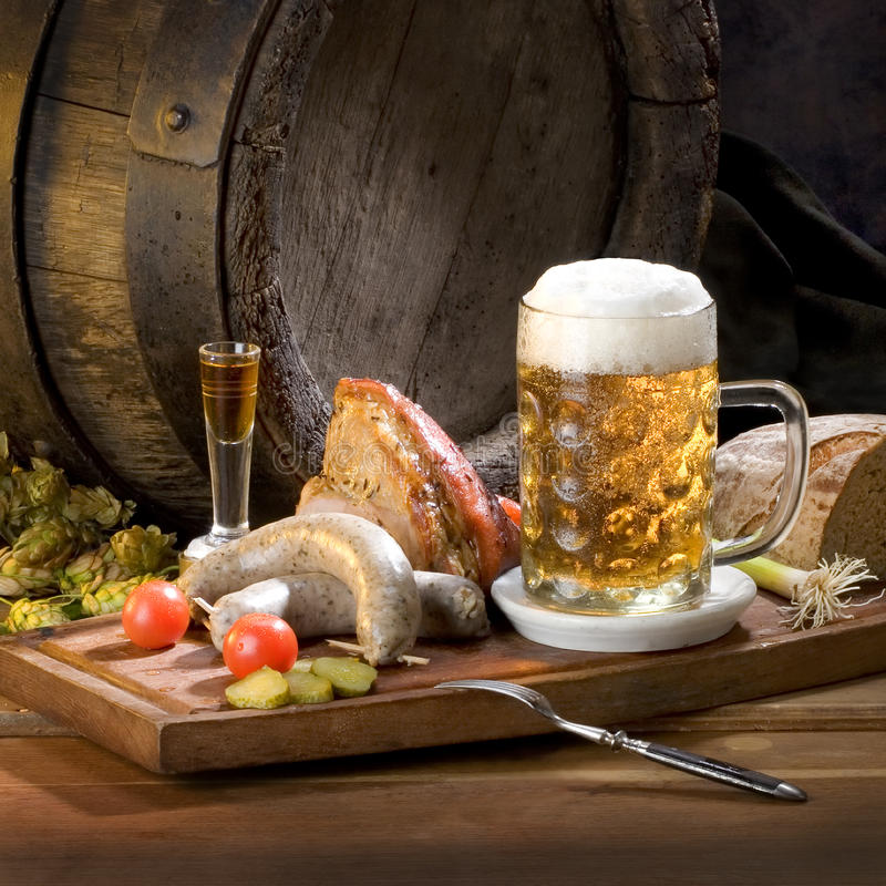 Still life with beer and food. Indoor royalty free stock photography