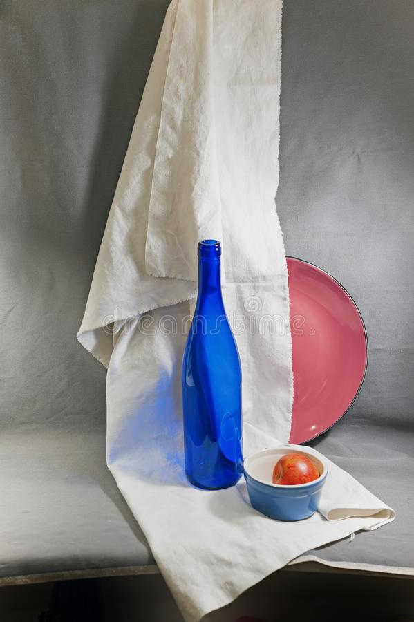 Still life with a blue bottle royalty free stock image