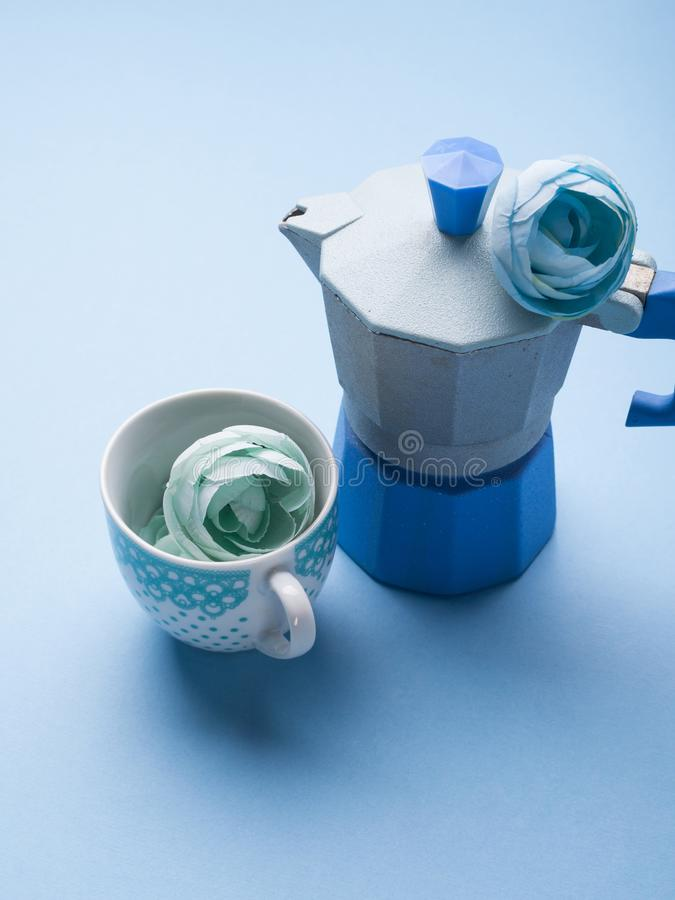 Still life with blue coffee maker and flower stock images