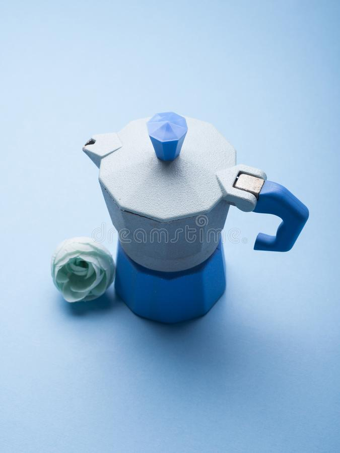 Still life with blue coffee maker and flower stock photos