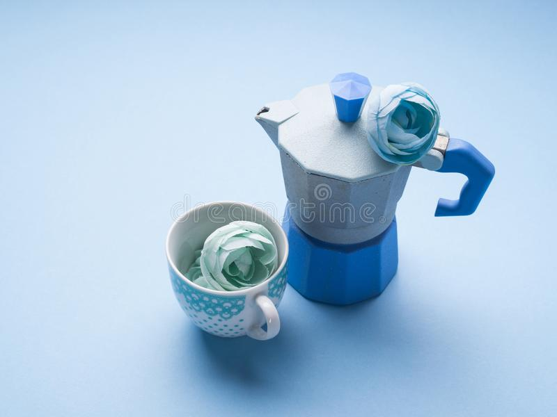 Still life with blue coffee maker and flower stock image