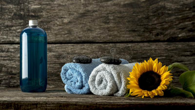 Still life with blue and white rolled towels with a black zen st stock images