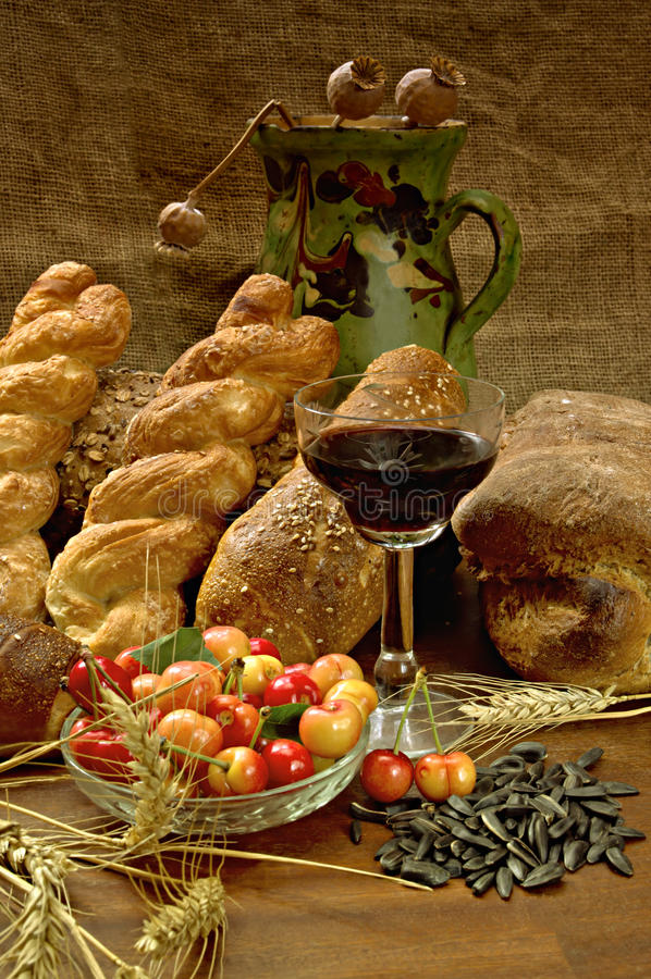 Still life with bread, cherrys, and wine stock photography
