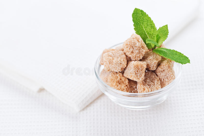 Still Life With Brown Cane Sugar, On White Linen Stock Photos