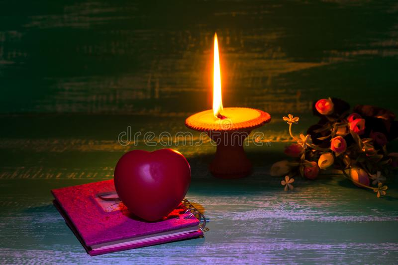 still life candlestick with heart sign stock photo
