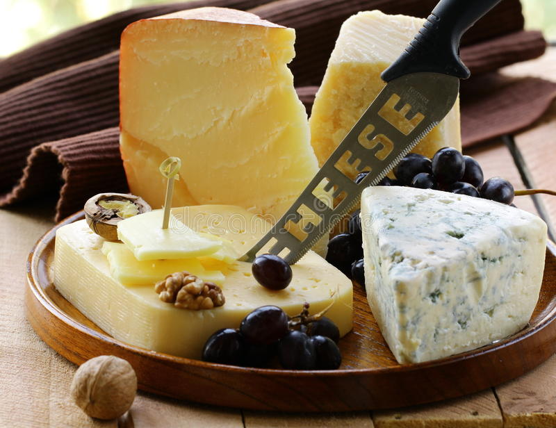 Still-life cheese platter with nuts royalty free stock image