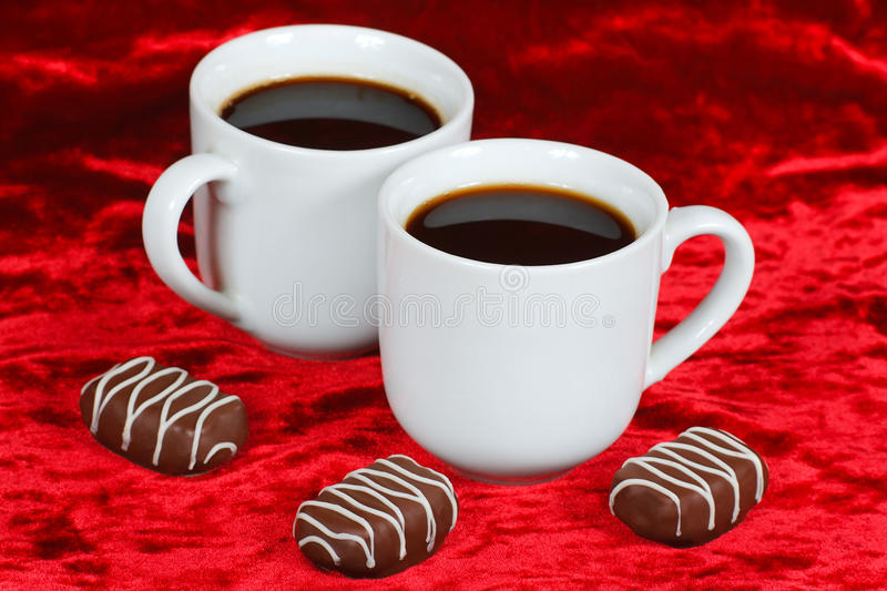 Still life of chocolate candy and coffee royalty free stock images