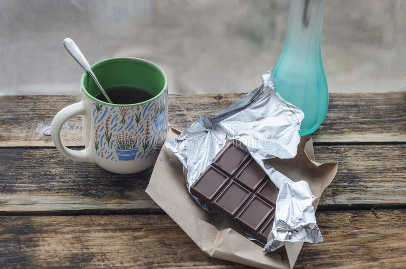 Still life. Chocolate with cup of tea and Breakfast at sunny spring or summer morning. stock images
