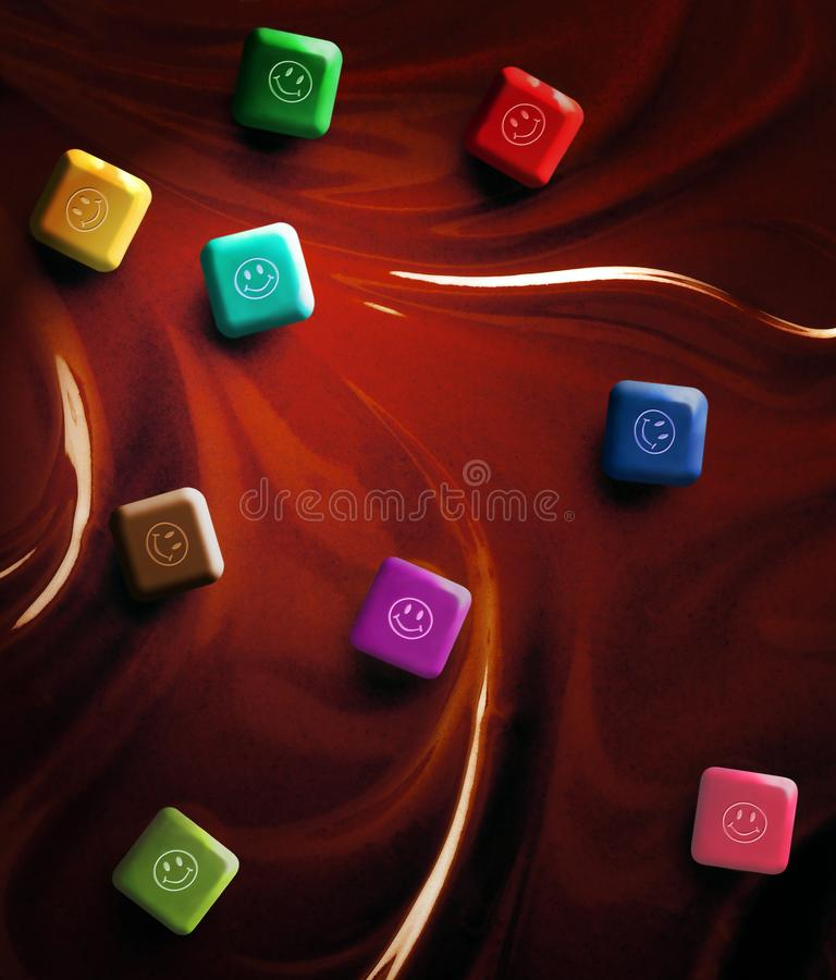 STILL LIFE OF CHOCOLATE SQUARES WITH HAPPY FACES SITTING ON CHOCOLATE SWIRLS royalty free stock image
