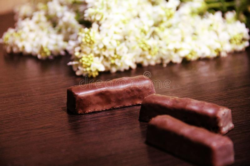 Still life: chocolates and flowers royalty free stock photo
