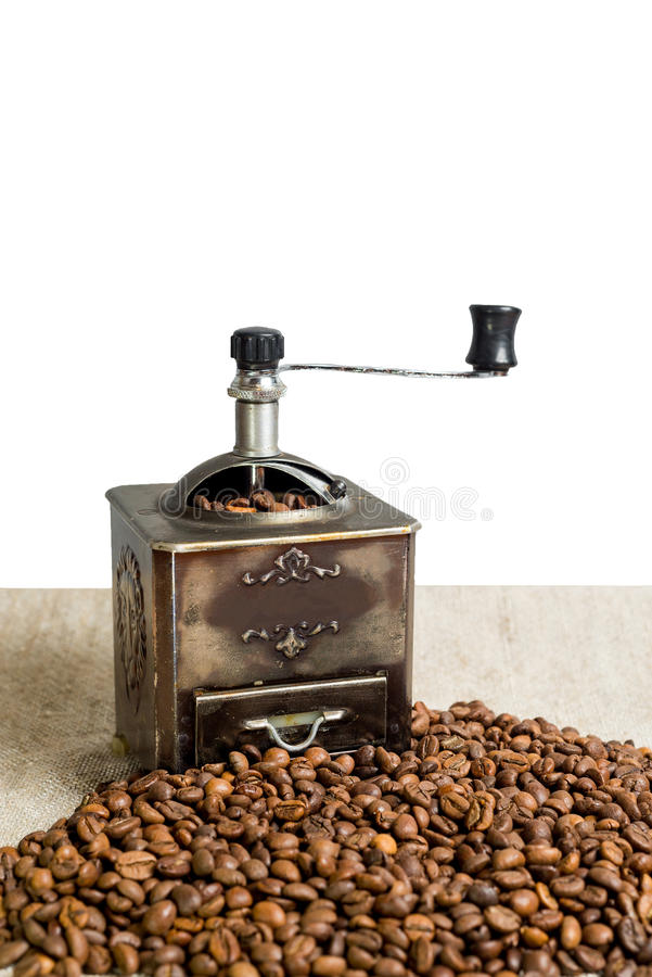 Still life with coffee beans and old coffee mill on the wooden background royalty free stock images