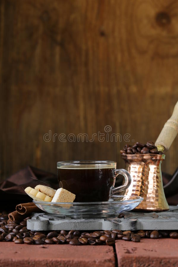 Still life coffee cup espresso beans and coffee pot. On a wooden table stock photos