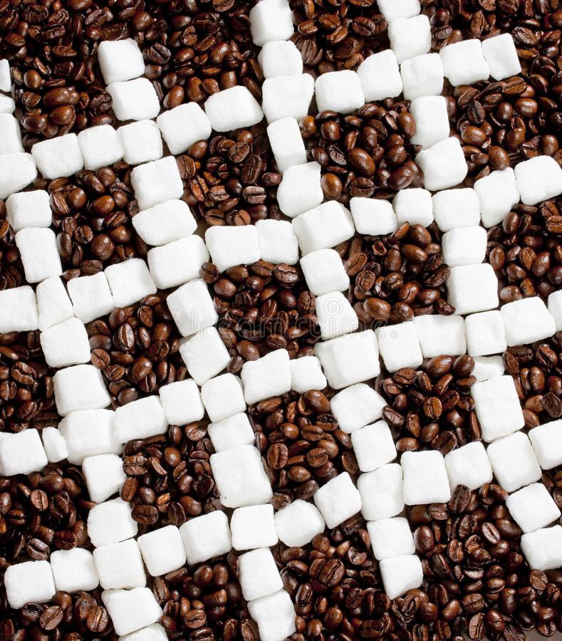 Still life of coffee and sugar. Inside, indoors, interiors, food, cafe, beans, roasted, caffeine, white, cubes, square, sweet, brown, many, abundance, abundant royalty free stock photo