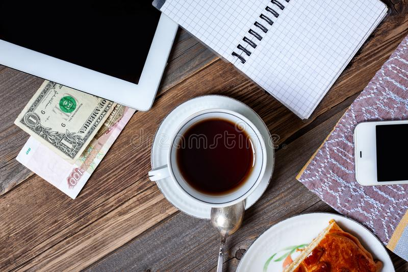 Still life with coffee or tea, cake and gadgets royalty free stock images