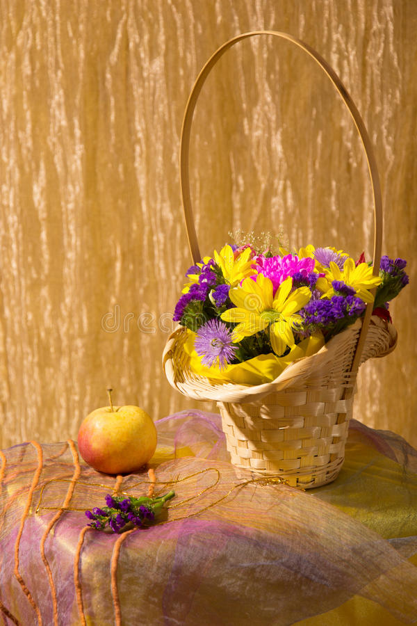 Still life with colorful fresh flowers. In a basket stock photography