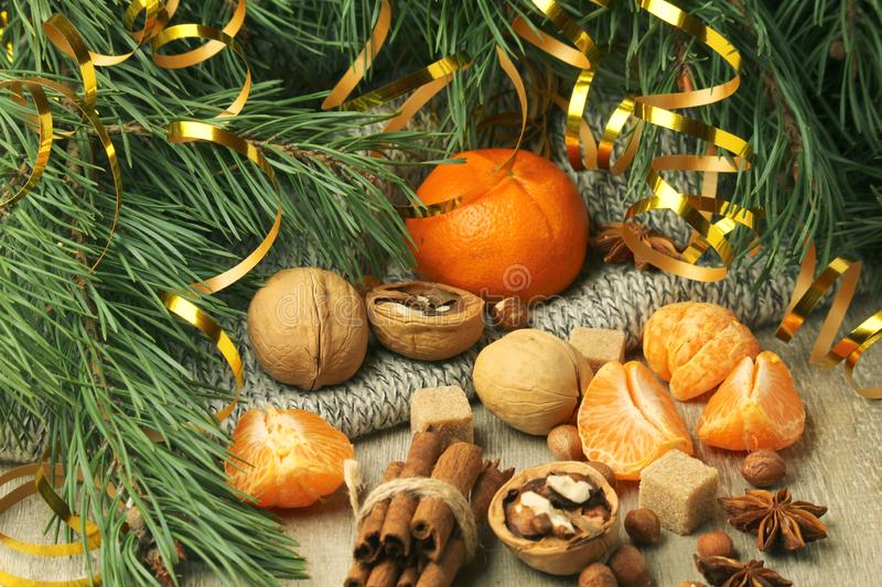 Still life composition formed with pine branches and New Year sweets. Oranges and pine branches form flat still life background for Christmas and New Year royalty free stock image