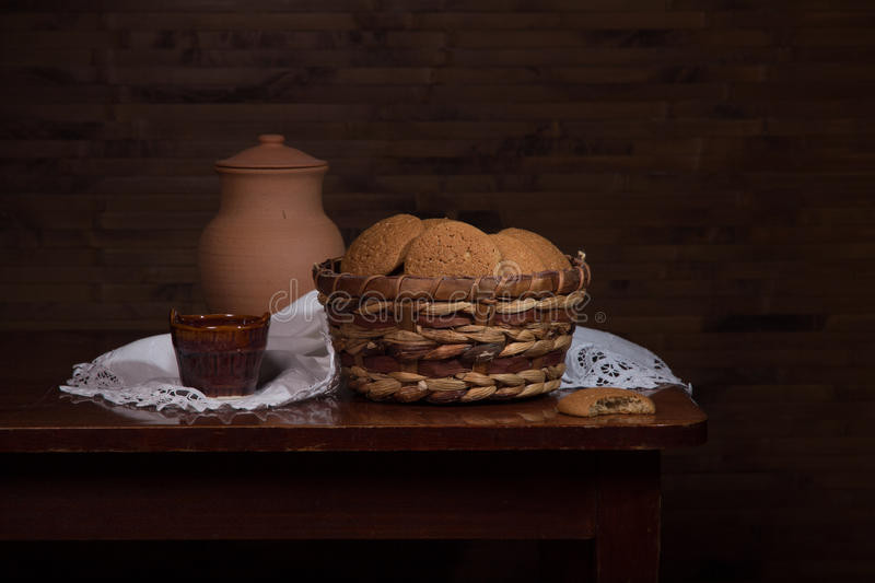 Still life with cookies in a basket. Vintage still life with cookies in a basket stock photos