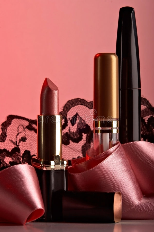 Still life with cosmetics. On the rose background stock photos