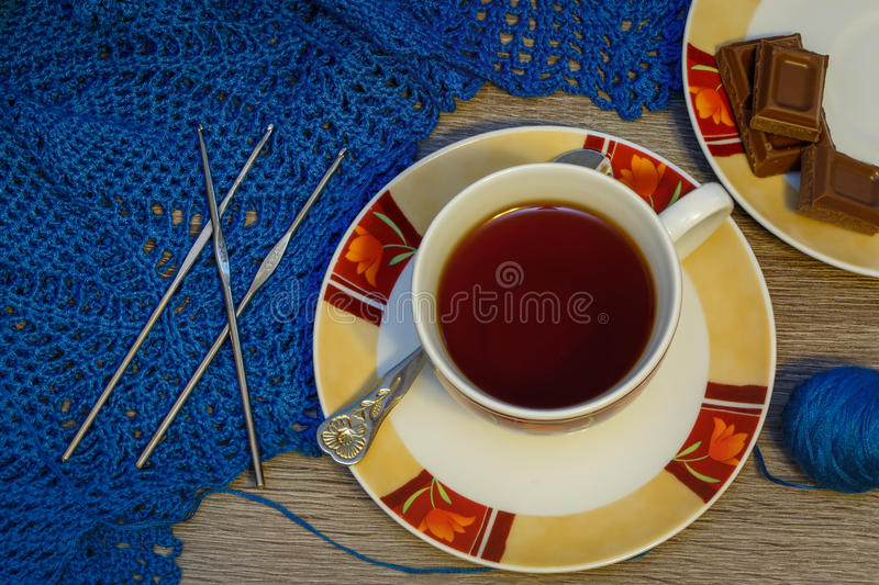Still life with crochet, tea and chocolate stock images