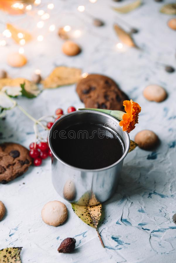 Still life cup with black tea on a white background with cookies and autumn leaves. stock photo