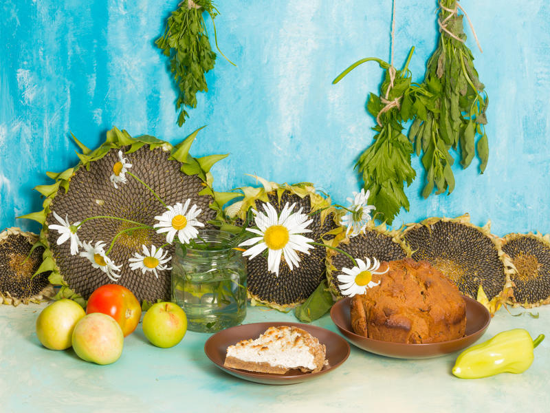 Still life with daisies and pastries stock photography