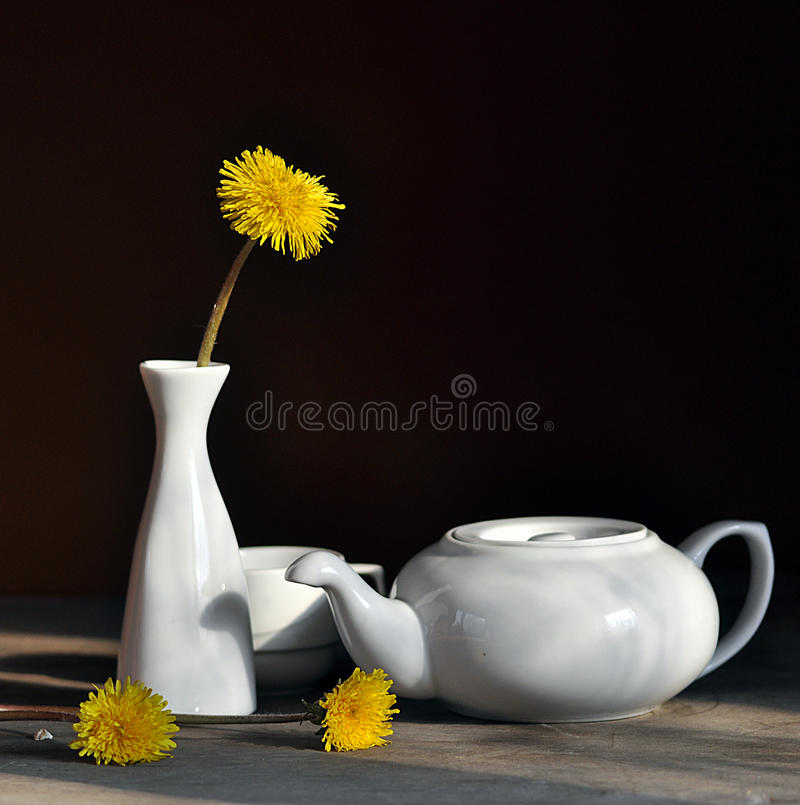 still life with dandelions and white tea-pot stock photography