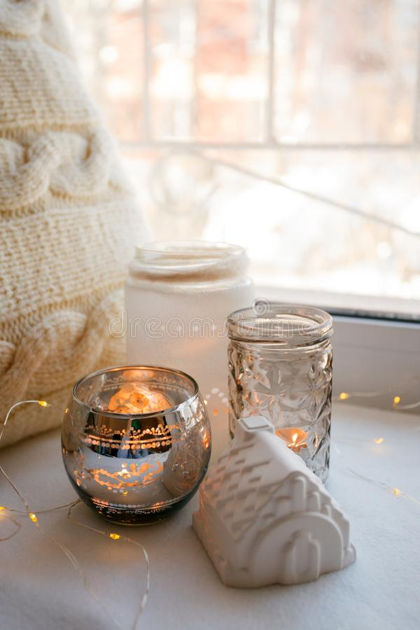 Still life details with candles, toy house and garland. Scandinavian hygge concept, monochrome, kinfolk style.  stock image