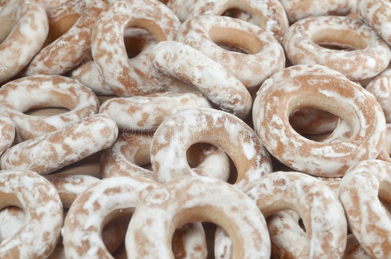 Still life of donut glaze on a wooden surface. Glazed bagels are a small bunch on a wooden table. Flour sweets to the Tea Part royalty free stock photo