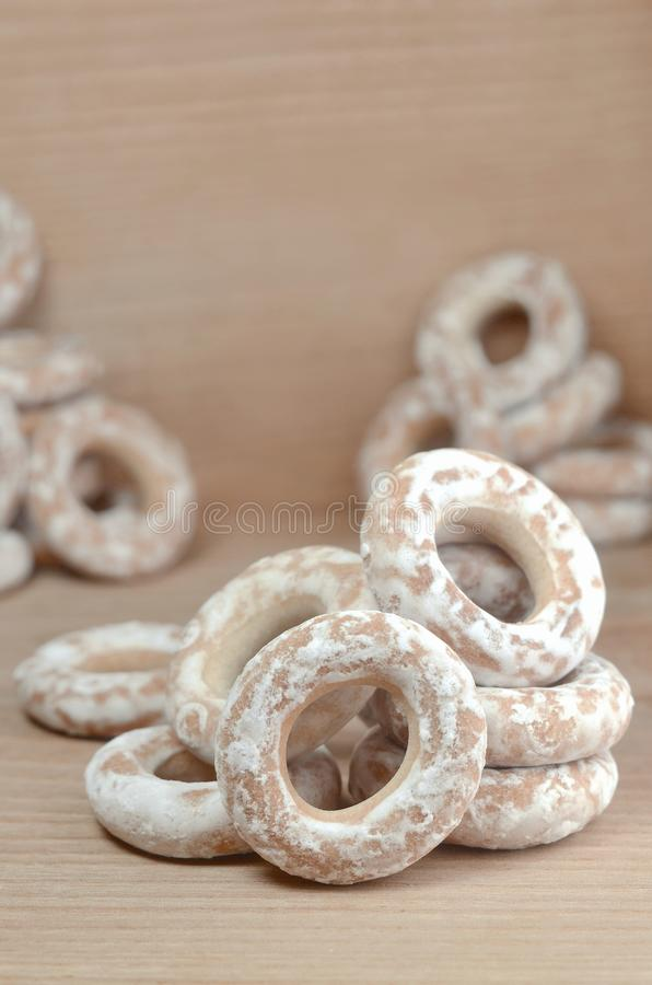 Still life of donut glaze on a wooden surface. Glazed bagels are a small bunch on a wooden table. Flour sweets to the Tea Part royalty free stock image