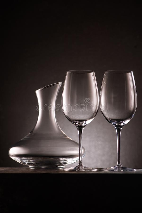 still life of empty decanter and wineglasses royalty free stock photography