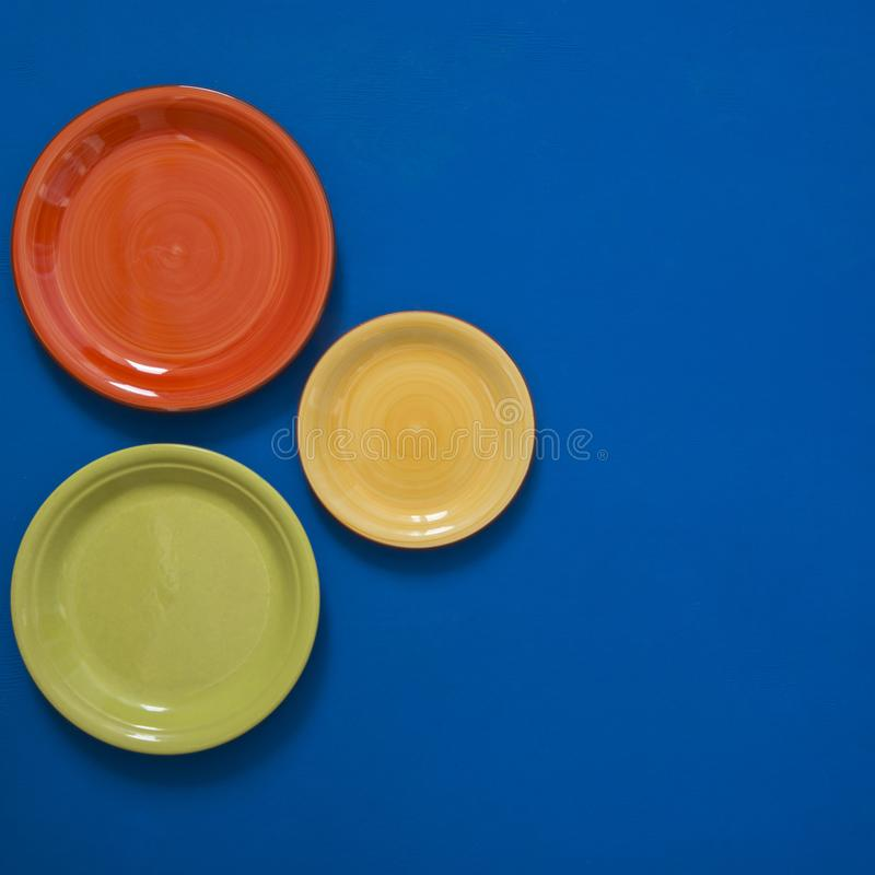 Free Still Life - Few Colorful Dishes On The Edge Of A Blue Background Stock Photo - 112129760
