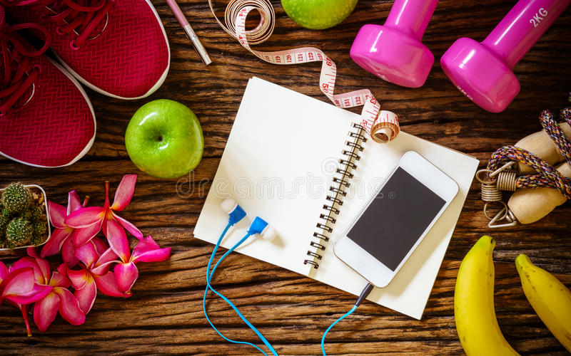 Still Life - Fitness, healthy and active lifestyles Concept, dumbbells, sport shoes, measuring tape, Jump rope, bananas, apples s stock photos