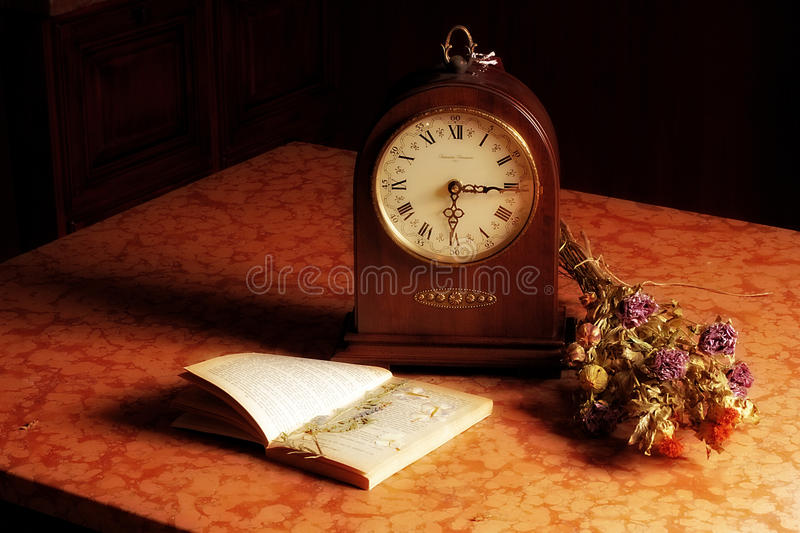Still life with flowers and a clock stock images