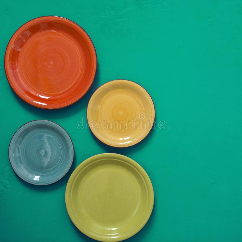 Free Still Life - Four Colorful Dishes On The Edge Of A Green Background Royalty Free Stock Photo - 112129775