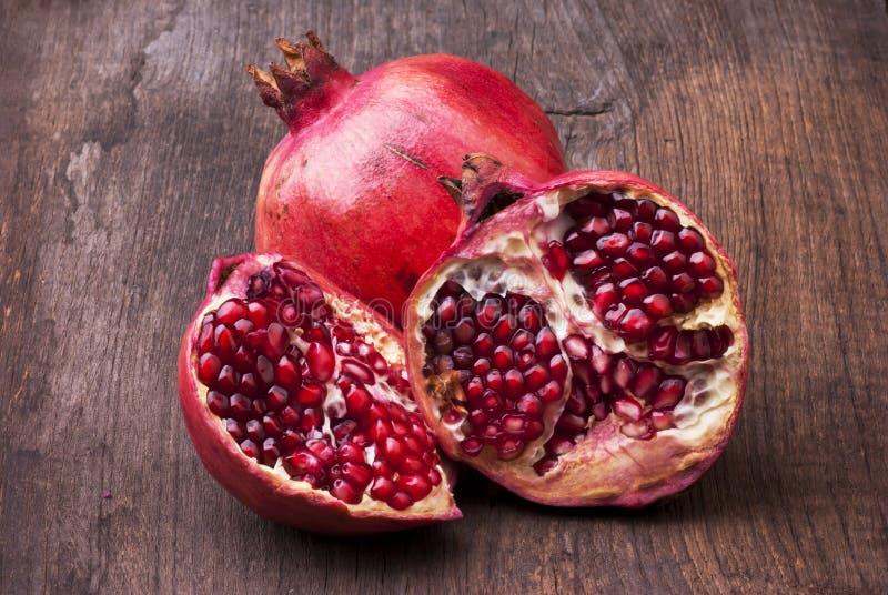 Still life.fresco pomegranate with seeds stock photos