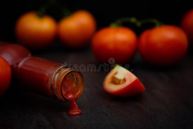 Still life of fresh ripe tomatoes sauce royalty free stock image
