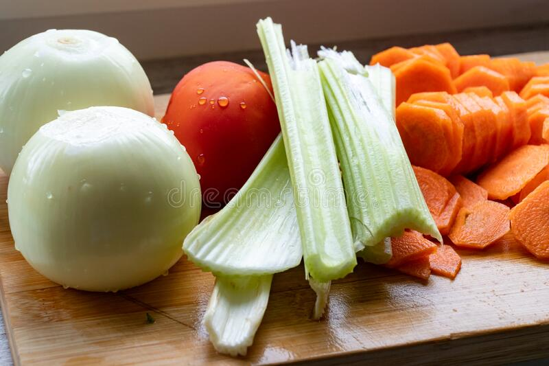Still life of fresh vegetables on cutting board. Fresh vegetables stock images