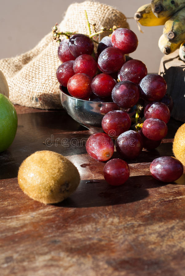 Still life Fruits with Chinese pear,kiwi,Red apple,grapes and Cu stock photography
