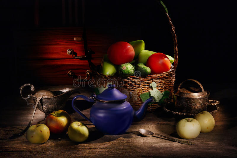 Still life of fruits and vegetables in a basket royalty free stock photo